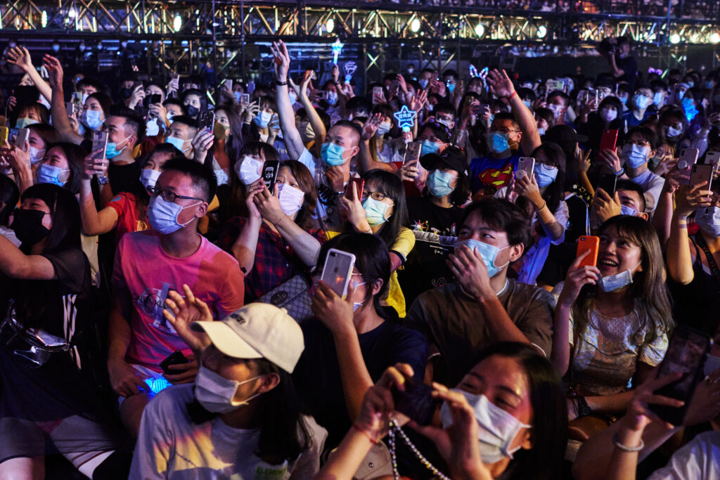 Concert attendees with face mask.